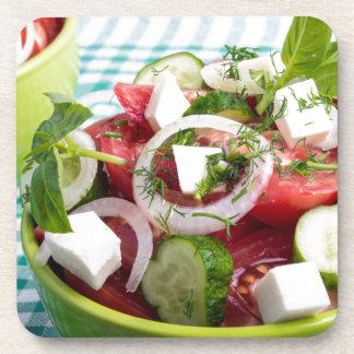 Nützlicher vegetarischer Salat mit rohen Tomaten Untersetzer