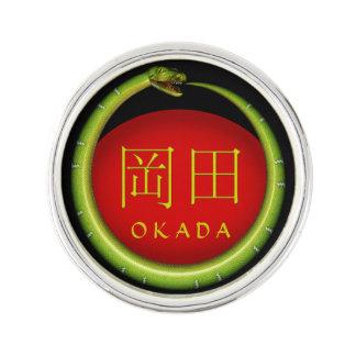 Okada-Monogramm-Schlange Anstecknadel