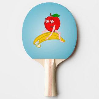 Osteopath-Frucht lustiges Apple, das eine Banane Tischtennis Schläger