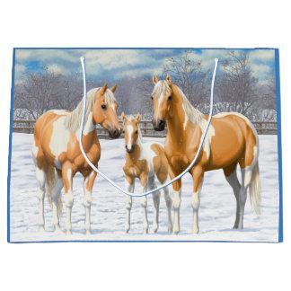 Palomino-Farben-Pferde im Schnee Große Geschenktüte