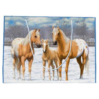 Palominoappaloosa-Pferde im Schnee Große Geschenktüte