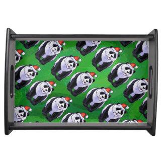 Panda-Bär in der Weihnachtsmannmütze auf Grün Serviertablett
