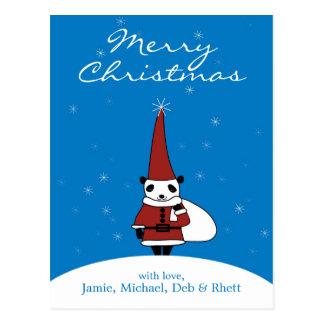 Panda, der Weihnachtsmann-Kostüm tragen und Postkarte