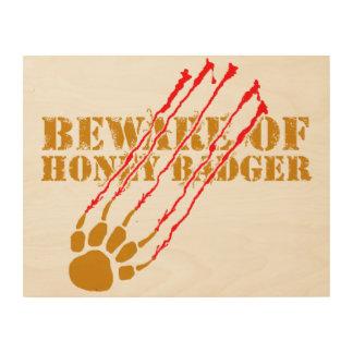 Passen Sie vom Honigdachs auf Holzdruck
