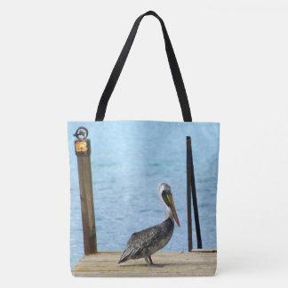 Pelikan auf dem Pier, Curaçao, karibische Inseln Tasche