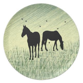 Pferde auf dem Gebiet Teller
