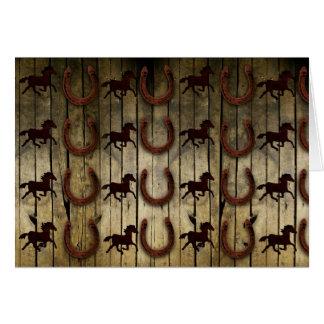 Pferde und Hufeisen auf hölzernen backround Karte