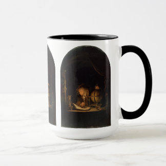 Philosophen-Alchemist, der durch Kerzenlicht Tasse
