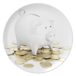 Piggy Bank und Münzen Teller