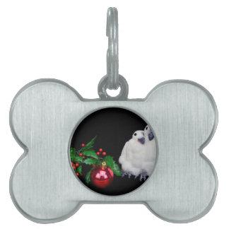 Pinguinfigürchen mit rotem Weihnachtsball Tiermarke