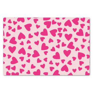 Pink-Herzen auf hellrosa Hintergrund Seidenpapier