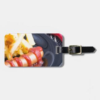 Platte mit einem Teil gebratenen Kartoffeln Gepäckanhänger
