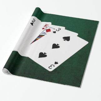 Poker übergibt - drei einer Art - zwei Geschenkpapier