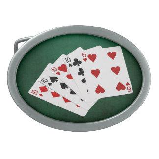 Poker übergibt - vier einer Art - zehn und sechs Ovale Gürtelschnalle
