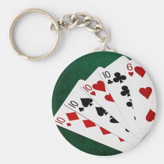 Poker übergibt - vier einer Art - zehn und sechs Schlüsselanhänger