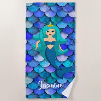 Prinzessin auf blauem und lila strandtuch