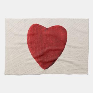 Putzhintergrund mit Herz Handtuch