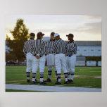 Referenten des amerikanischen Fußballs, die auf de Posterdrucke