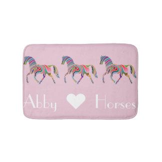Regenbogen-Pferde auf Rosa Badematte