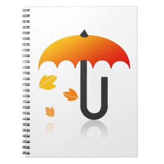 Regenschirm und Blätter Notizblock
