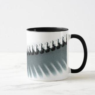 Reißverschluss beschattet Tasse