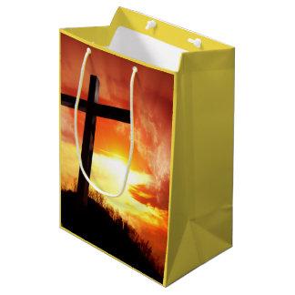Religiöses Ostern-Kreuz am Sonnenuntergang Mittlere Geschenktüte