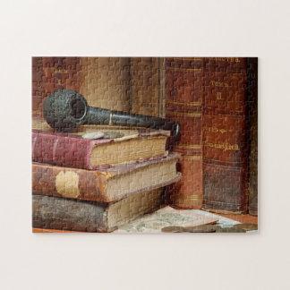 Rohr auf Buch-Puzzlespiel Puzzle