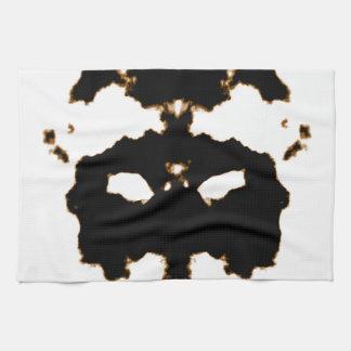 Rorschach Test einer Tinten-Fleck-Karte auf Weiß Handtuch