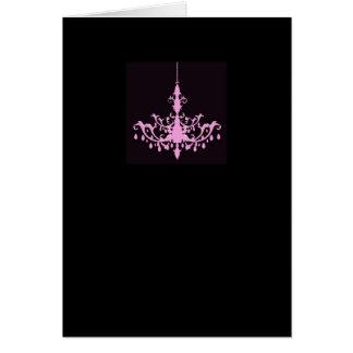 Rosa Leuchter auf schwarzer Karte