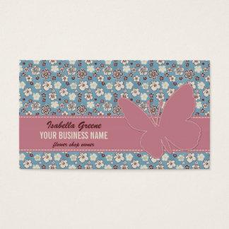 Rosa Schmetterling auf Vintagem blauem mit Visitenkarte