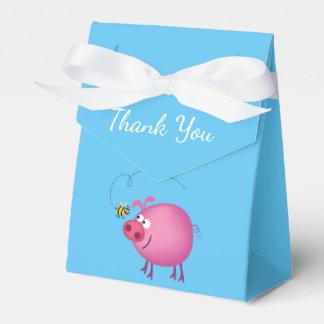 Rosa Schwein u. freundlicher Geschenkschachtel