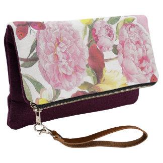 Rosa und gelber Schmetterlings-Iris-mit Clutch