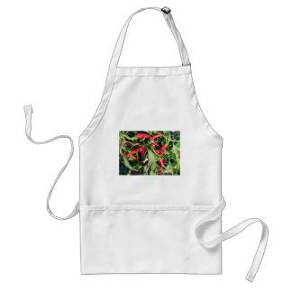 Rote Chili-Paprikaschoten, die an der Pflanze Schürze