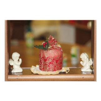 Rote Feiertags-Kerze mit das Foto-Erweiterung des  Photographischer Druck