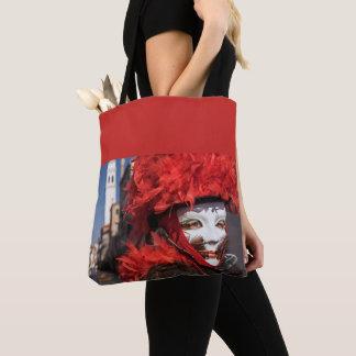 Rote Karnevalsmaske in Venedig, Italien Tasche
