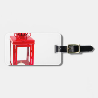 Rote Laterne mit brennendem tealight auf Weiß Kofferanhänger