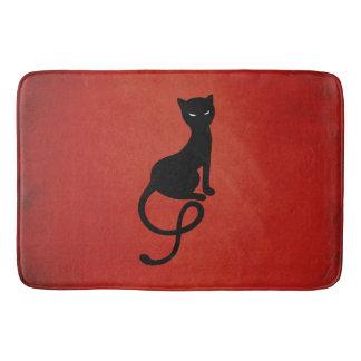 Rote liebenswürdige schlechte schwarze Katze Badematte