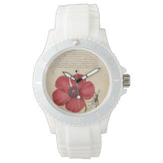 Rote Mohnblume und die Wanze Uhr