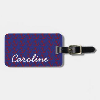 Rote nautischanker auf blauem personalisiertem gepäckanhänger