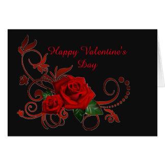 Rote Rosen des Valentines Tagesrot und schwarze Karte