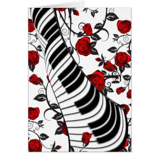 Rote Rosen und Klavierschlüssel Karte