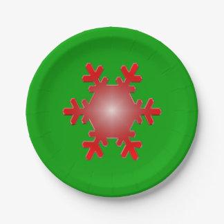 Rote Schneeflocke-Sternexplosion auf Grün Pappteller