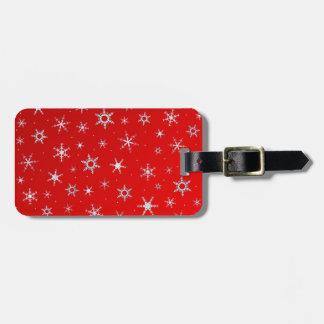 Rote Schneeflocken Gepäckanhänger