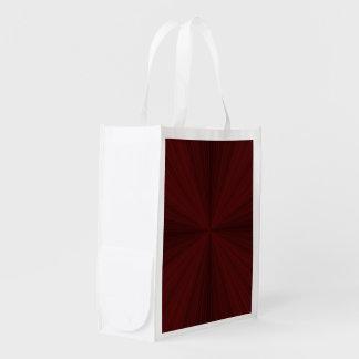 Rote Strahlen viertelten Einkaufstüte Tragetaschen