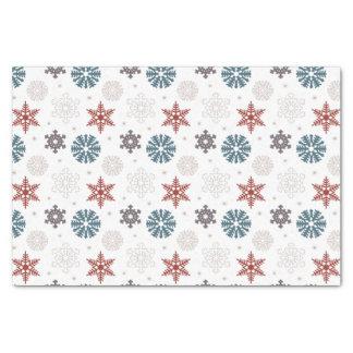 Rote und blaue patriotische Schneeflocken auf Seidenpapier