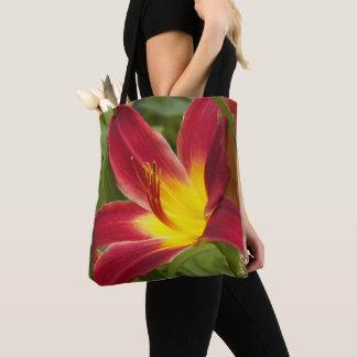 Rote und gelbe Taglilie mit Blumen Tasche