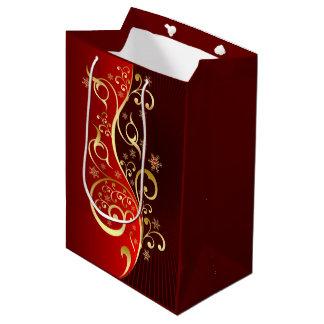 Rote und goldene mittlere Geschenk-mit Mittlere Geschenktüte