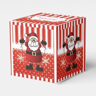 Rote und weiße Süßigkeits-Streifen und Geschenkschachtel