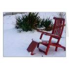 Roter Garten-Stuhl/Roter Liegestuhl im Schnee Karte