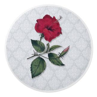 Roter Hibiskus mit Spitze-Hintergrund Keramikknauf
